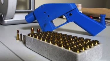 TO GO WITH AFP STORY BY ROBERT MACPHERSONA Liberator pistol appears on July 11, 2013 next to the 3D printer on which its components were made. The single-shot handgun is the first firearm tha