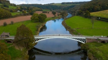 A person crosses from England to Wales over Bigsweir Bridge