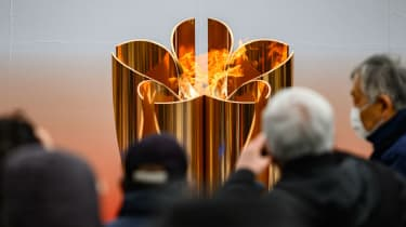 The Tokyo 2020 Olympic flame is displayed at Ofunato, Iwate prefecture in Japan