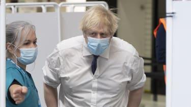 Boris Johnson visits a vaccination centre.