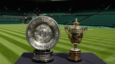 The Wimbledon women's and men's singles trophies on display at Centre Court