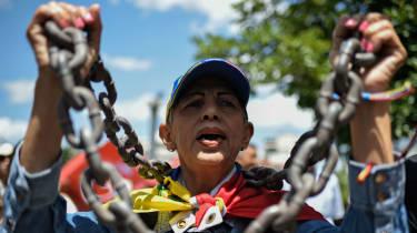 An opposition demonstrator in Caracas last week