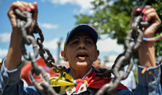 An opposition demonstrator in Caracas last week