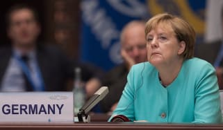 HANGZHOU, CHINA - SEPTEMBER 4: German Chancellor Angela Merkel listens to Chinese President Xi Jinping speech during the opening ceremony of the G20 Leaders Summit on September 4, 2016 in Han
