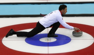 Britain's David Murdoch takes part in a training session at the Ice cube curling centre during the Sochi Winter Olympics on February 11, 2014.AFP PHOTO / ADRIAN DENNIS(Photo credit should rea