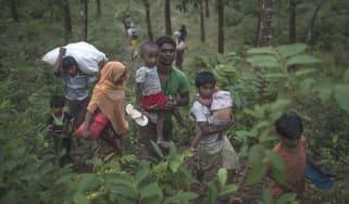 Rohingya Muslim refugees cross the border into Myanmar