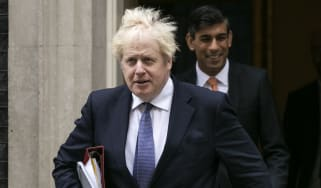 Boris Johnson leaves Downing Street flanked by Chancellor Rishi Sunak