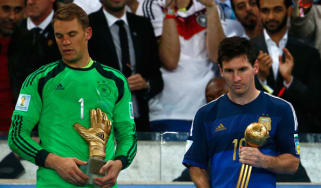 Lionel Messi of collects the Golden Ball trophy in Rio