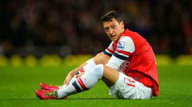 A dejected Mesut Ozil, Arsenal's record signing