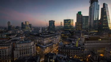 Automobiles create light trials as they pass the Bank of England (BOE), center, at dawn in the City of London, U.K., on Monday, Feb. 25, 2019. The U.K. and U.S. sought to allay fears of disru