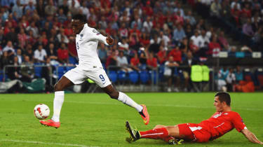 Danny Welbeck of Arsenal scores for England against Switzerland