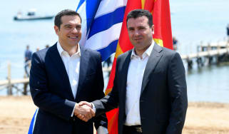 Macedonian Prime Minister Zoran Zaev welcomes his Greek counterpart Alexis Tsipras ahead of Sunday's signing ceremony