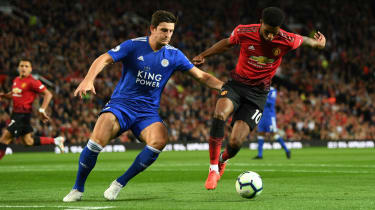 Leicester City's Harry Maguire in action against Manchester United striker Marcus Rashford