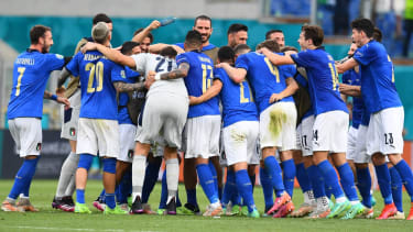 Italy players celebrate their group A win over Wales at Euro 2020