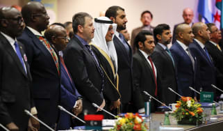 Abdulaziz bin Salman, Saudi Arabia's energy minister, fifth left, stands with other delegates for a minutes silence to pay tribute to the recently deceased Fadhil Chalabi, former acting secre