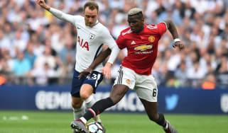 Tottenham Hotspur midfielder Christian Eriksen battles with Manchester United's Paul Pogba