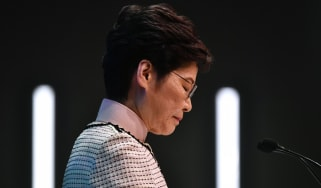 Hong Kong's Chief Executive Carrie Lam speaks at a press conference in Hong Kong on October 16, 2019, after she tried twice to begin her annual policy address inside the city's legislature. -