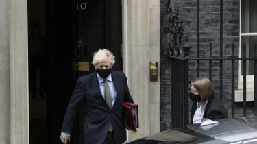 Boris Johnson leaves Downing Street wearing a face mask to attend Prime Ministers' Questions