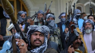 Afghan militia arm themselves to aid the military in the fight against the Taliban