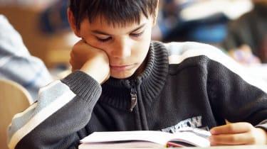 A schoolchild reading a book