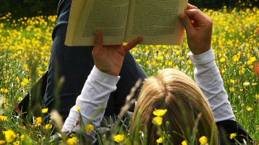 A teenager reading a book