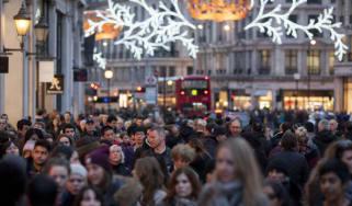 LONDON, ENGLAND - DECEMBER 14: Hordes of Christmas shoppers walk beneath festive lights on Regent Street on December 14, 2013 in London, England. As Christmas Day approaches, London's central
