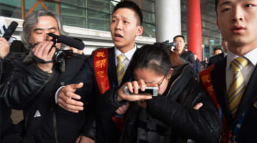 Relative of Malaysia Airlines passenger cries in Beijing