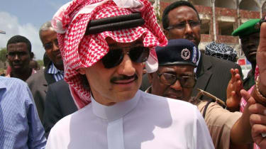 Prince Al-Waleed Bin Talal, nephew of the Saudi King, is guided on his visit to the Somalian capital, Mogadishu on August 27, 2011. A delegation from the Saudi royal family arrived today in M