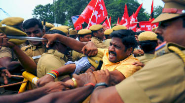 Police step in during a demonstration against the Indian government's dismissal of a proposal on water-sharing rights