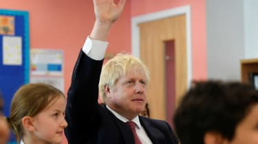 Boris Johnson attends a year six history class with pupils during a visit to Pimlico Primary school.