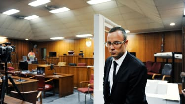 Paralympian Oscar Pistorius is seen in the courtroom after his murder trial was postponed at the high court in Pretoria on March 28, 2014. The judge overseeing Oscar Pistorius's murder trial