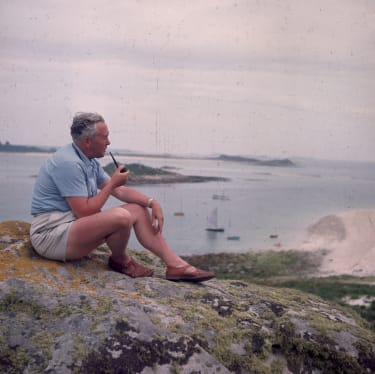 10th August 1965:British Labour politician and Prime Minister Harold Wilson (1916 - 1995) sitting quietly smoking his pipe on a rock, during his holiday to the Scilly Isles.(Photo by Peter Ki