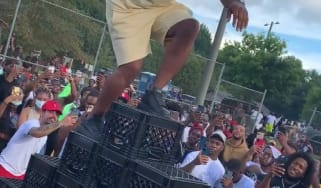 Person participating in the milk crate challenge