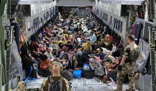 German soldiers waiting to evacuate a group of Afghan civilians