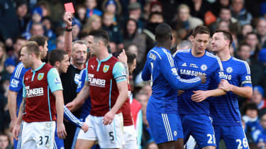 Chelsea's Serbian midfielder Nemanja Matic leaves the pitch after receiving a red card during the English Premier Lea