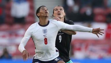England's Jude Bellingham battles with Austria's Marcel Sabitzer