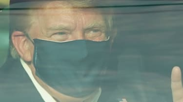 Donald Trump on a surprise drive to thank supporters outside Walter Reed hospital.