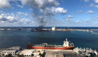 TRIPOLI, LIBYA - FEBRUARY 18: Smoke rises after warlord Khalifa Haftarâs forces launched an attack on a port near the Martyrs' Square, where celebration events marking the 9th anniversary of