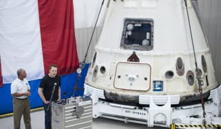 MCGREGOR, TX - JUNE 13:In this handout from NASA, SpaceX CEO and Chief Designer Elon Musk (R) speaks as NASA Administrator Charles Bolden, listens next to the Dragon capsule at the SpaceX fac