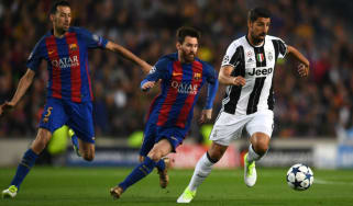 Sami Khedira of Juventus and Lionel Messi of Barcelona