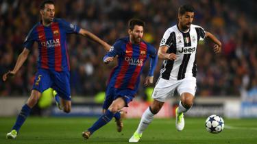Sami Khedira of Juventus and Lionel Messi of Barcelona