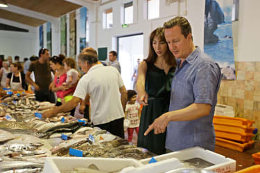 ALJEZUR. PORTUGAL - JULY 26: British Prime Minister David Cameron and his wife Samantha Cameron look at fish in the market of Aljezur on July 26 in Aljezur, Portugal. The Prime Minister is sp