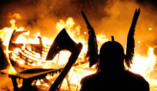 The Guizer Jarl or Chief of the Jarl viking squad is silhoutted by a burning viking longship during the annual Up Helly Aa Festival, Lerwick, Shetland Islands, January 26, 2010. Up Helly Aa c