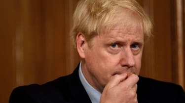 Boris Johnson speaks during a virtual press conference inside 10 Downing Street