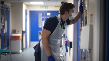 A Rehab Support worker checks on a patientas the first patients are admitted to the NHS Seacole Centre at Headley Court, Surrey on May 28, 2020, a disused military hospital, which has been co
