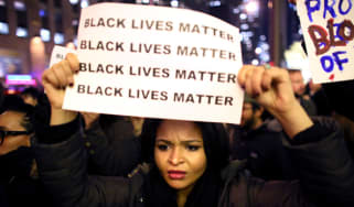 NEW YORK - DECEMBER 3: Demonstrators walk together during a protest December 3, 2014 in New York. Protests began after a Grand Jury decided to not indict officer Daniel Pantaleo. Eric Garner