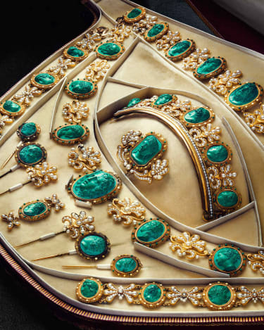 An original parure or jewellery set owned by the Empress featuring pearls and malachite cameos of Greek gods