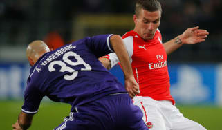 Anthony Vanden Borre of Anderlecht battles with Lukas Podolski of Arsenal