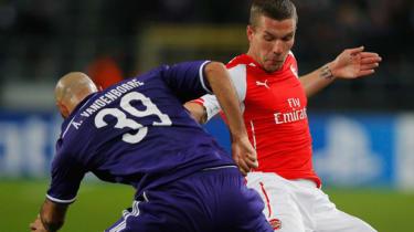 Anthony Vanden Borre of Anderlecht battles with Lukas Podolski of Arsenal