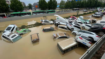 Flooded road and floating cars